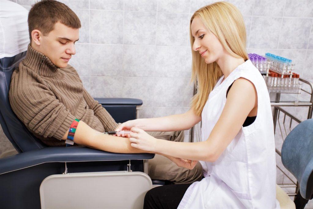 Certified Nursing Aide Drawing Blood