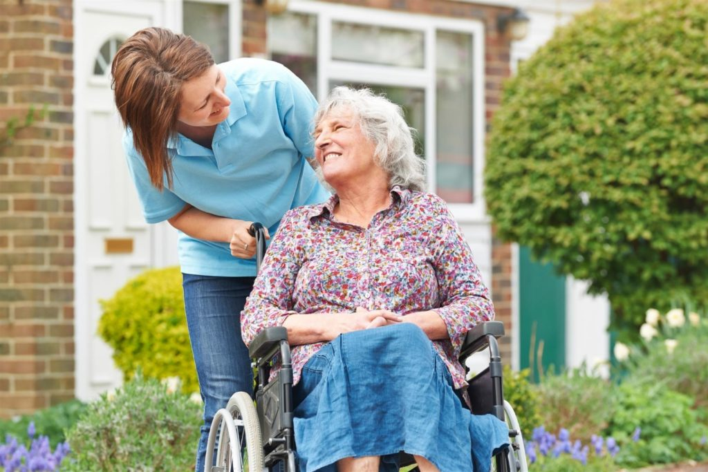 Home Health Aide with Patient in Wheelchair